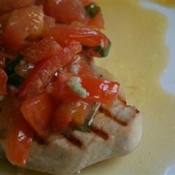 Glasser's Greek Marlin Recipe - Marlin steaks with a tomato and basil topping, cooked in a garlic butter sauce. This fish is terrific served with Greek olives and feta cheese.