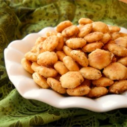 Tasty Seasoned Oyster Crackers  Recipe - Cool ranch seasoning and dill sets these quick seasoned crackers apart and makes them so perfect to crunch by the handful, use as a dipper, top a salad, or serve with a bowl of soup.