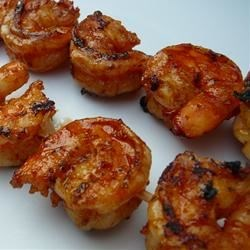 Grilled Garlic and Herb Shrimp Recipe - Large, plump shrimp are marinated in a savory sauce of lemon juice, garlic, Italian seasoning, olive oil, dried basil, and brown sugar, then grilled to highlight the flavors.