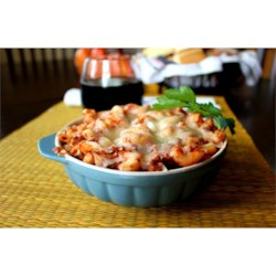 Mozechilli Casserole Recipe - Simple layers of cooked ground beef, ready-made spaghetti sauce, rotini pasta and mozzarella cheese bake into a quick and easy meal.