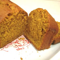 Pumpkin Bread IV Recipe - You might as well bake pumpkin bread in the large batch called for here, because everyone  loves it. Three full-sized loaves, lively with cinnamon, cloves and nutmeg, are your reward. Wrap loaves in cellophane, tie with a colorful ribbon, and give as a gift!