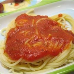 Garlic Spaghetti I Recipe - A hefty dose of minced garlic gets a quick saute in olive oil before simmering with tomato sauce and oregano. Pour over hot spaghetti and serve with a grating of Parmesan.