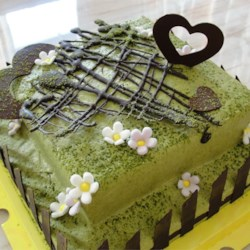 Green Tea Layer Cake Recipe - This is a light and moist cake that is not too sweet and has a refreshing green tea fragrance. The frosting uses cream cheese but has enough sweetness to mask the sour taste. The matcha (green tea) powder gives it a delicate green hue too. This cake can also be baked as a sheet cake in a 9x 13 inch pan or as 2 separate round cakes in two 8 inch round pans. Adjust baking time accordingly.