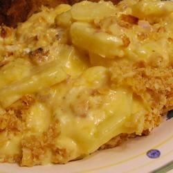 Cindy's Really Good Au Gratin Potatoes Recipe - Cheddar cheese and dry mustard powder are the secret ingredients in these family-famous au gratin potatoes.