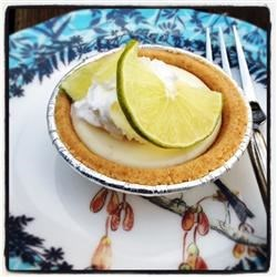 Mini Key Lime Pies Recipe - Nothing taste better than key lime pie made with fresh key limes. This one is really tasty and super simple to make. Mini pies are great because everyone can have their own.