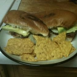 Mexican Steak Torta Recipe - A Mexican sandwich filled with char grilled steak, beans, avocado, lettuce, and tomato all served up on a warm toasted roll.