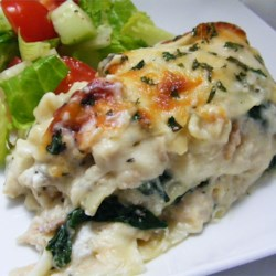 White Cheese Chicken Lasagna Recipe and Video - Thick with an abundance of mozzarella, Parmesan and ricotta cheeses, this chicken and spinach lasagna could make you forget all about the tomato kind!