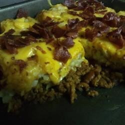 Triple Bypass Recipe - Chili cheese fries is reinvented as a casserole in this indulgent Super Bowl snack.