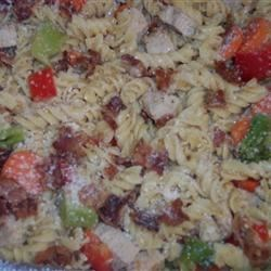 Rotelle Pasta Salad Recipe - A garden of vegetables with turkey and chunks crunchy bacon bits topped with Cheddar cheese.