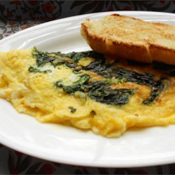 Baby Spinach Omelet Recipe - Tender baby spinach, Parmesan cheese, and a little nutmeg flavor this simple, delicious omelet.