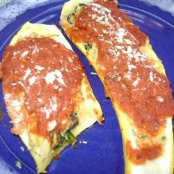 Ricotta Stuffed Squash Recipe - Zucchini is stuffed with a ricotta cheese and spinach mixture, and baked with tomato sauce.