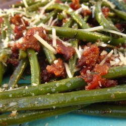 Fiance's Favorite Savory Green Beans Recipe - Green beans are cooked with the savory flavors of bacon, balsamic vinegar and Italian seasonings, then topped with Italian cheese blend for an easy and flavorful stovetop side dish.