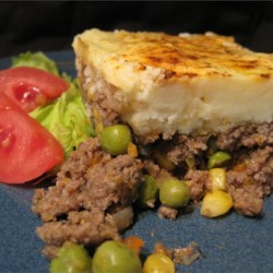 Shepherd's Pie V Recipe - Ground beef and frozen vegetables are seasoned and topped with mashed potatoes. This is a handy, quick dinner casserole!
