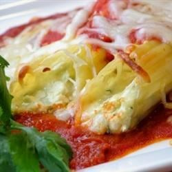 Make Ahead Manicotti Recipe - The secret to this marvelous manicotti is in the chill. After stuffing cooked pasta with a tasty blend of spinach, Parmesan, mozzarella and a dash of sugar, arrange tomato sauce and shells in a baking dish and chill overnight. Bake it the next day!