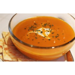 Curried Carrot Soup Recipe - Carrots cooked in vegetable broth are pureed with curry powder and sauteed onions in this gorgeous vegetarian soup. Garnish with golden raisins or a dollop of sour cream.