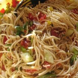 Spaghetti Salad III Recipe - Toss a cool summer salad with lots of chopped tomatoes, bell peppers, onion, cucumber, Cheddar cheese and Italian seasoning. Mix in cooked pasta, then blanket with Italian-style salad dressing. Chill thoroughly before serving.