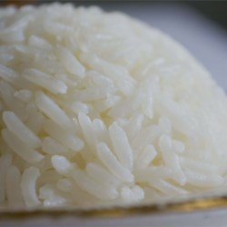 Coconut Rice Recipe - Basmati rice is simmered in coconut milk, instead of water, giving it a rich flavor.