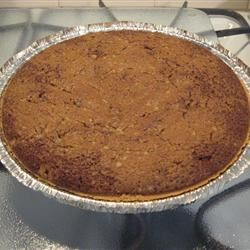 Shoofly Pie III Recipe - This simple pie's molasses filling is stirred up, combined with a brown sugar crumble, and poured into a prepared crust. Then a bit more crumble is sprinkled on the top. Serve it with whipped cream or ice cream.
