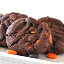 Perfect Double Chocolate Peanut Candy Cookies Recipe - Chocolate cookies are loaded down with chocolate chips and peanut butter candies for a chocolatey-peanutty combination that can't be beat.