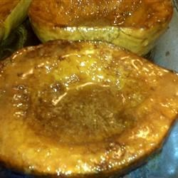 Golden Baked Acorn Squash Recipe - To warm up a winter meal, offer sweet acorn squash halves flavored with a hot orange-brandy sauce.