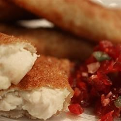 Thanksgiving Leftover Wontons with Cranberry Salsa Recipe - Wontons, those small crisp appetizers originally from China, get a new fusion of flavors when stuffed with a creamy turkey filling and served with tangy, spicy cranberry salsa.