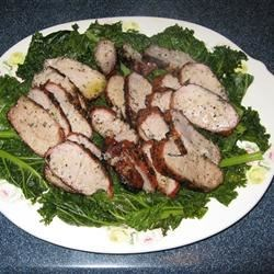 Pork Tenderloin with Steamed Kale Recipe - This is one of my favorite meals: pork tenderloin medallions atop crisp steamed greens, drizzled with a robust olive oil and lime juice dressing.  It is wonderful served with brown rice on the side and the white or blush wine of your choice.