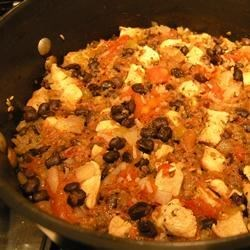 Chicken and Black Bean Casserole Recipe - I usually make this the day after we have roast chicken. The recipe calls for baking, but the ingredients can also be added to a slow cooker and cooked on Low for 7 hours. We serve this with cheese, tortilla chips, sour cream, salsa, black olives, and guacamole.
