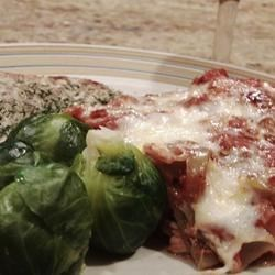 Grammy's Overnight Lasagna Recipe - This easy lasagna layers uncooked noodles with cheese, jarred marinara sauce, and crumbled ground beef.  After an overnight rest in the refrigerator, it bakes up soft, bubbly, and delicious.