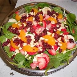 The Perfect Sunday Brunch Spinach Salad Recipe - Baby spinach is topped with a colorful array of fruit in this easy salad.