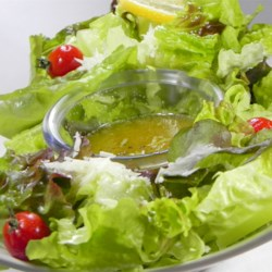 Romaine with Garlic Lemon Anchovy Dressing Recipe - Flavorful green salad. Can be prepared in 10 minutes or less.