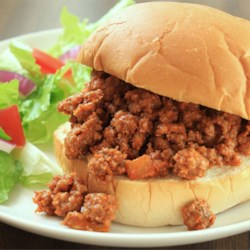 Sloppy Joes II Recipe and Video - Ground beef, onion, green pepper, and ketchup are seasoned with garlic powder and sweetened with brown sugar to make this hearty meat filling. Serve on hamburger buns.