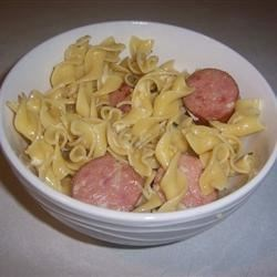 NuNu's and Hot Dogs Recipe - It's just buttered egg noodles with parsley, parmesan cheese, and hot dogs.