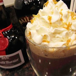 Leprechaun's Delight Recipe - Grand Marnier and Irish cream add some pep to a mug of hot coffee. This recipe is great on a cold winter day, or just use it to relax!