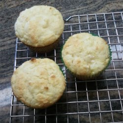 Pineapple Ricotta Muffins Recipe - Boxed cake mix muffins get a little yummier with the addition of canned pineapples and ricotta cheese.