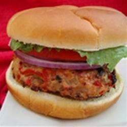 Cajun Chicken Burgers Recipe - TABASCO(R) Pepper Sauce, chopped peppers and onions, and Worcestershire sauce pile on the flavor in these burgers made with ground chicken or turkey.