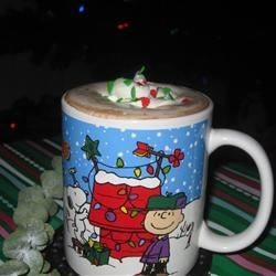 Cocoa Sleigh Ride Recipe - A festive cup of cocoa that will bring out the kid in everyone!  Top instant cocoa with whipped cream, red and green sprinkles and a cherry.  Use more or less toppings, as desired.
