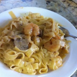 Angel Shrimp Pasta Recipe - Whip up a creamy, spicy shrimp sauce with sauteed onions, mushrooms, mushroom soup, jalapeno cheese and - of course - shrimp. You will love it over angel hair pasta.