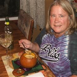 Lady Linda enjoying Veggie stew in a spicy cream sauce, served in a sugar pumpkin. YUM!