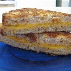 Death by Cheese Sandwich Recipe - A sinfully delicious cheese sandwich that is battered and fried. A favorite for adults and kids. This sandwich is great served with French fries and ketchup. Try dipping the sandwich into the ketchup, too. YUM!