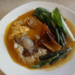 Kare Kare Pata (Oxtail Stew) Recipe - Slowly simmering the oxtails to make a rich broth delivers terrific flavor to this soup with bok choy, long beans, and eggplant.