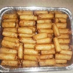 Lumpia Rolls Recipe - Deep fried lumpia rolls filled with a mixture of beef, pork and vegetables. Great for parties as they can be prepared ahead of time and frozen, then fried when you're ready to use.