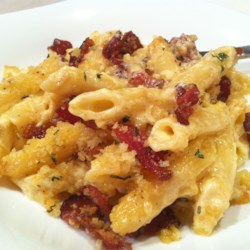 Copia's Penne Pasta and Cheese Casserole Recipe - This pasta casserole is rich and cheesy. Smoky bacon and bread crumbs are combined to make a tasty layer of crunch on top.