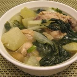 Chicken Tinola Recipe - This one-pot wonder combines chicken, chayote squash, bok choy, and spinach in a savory broth.