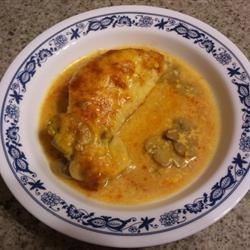 Chicken, Cheese, and Wine Recipe - Skinless, boneless chicken breast and Cheddar cheese baked in a sauce with white wine and mushrooms is an easy and delicious dinner option.