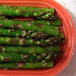 Broiled Asparagus with Lemon Tarragon Dressing Recipe - Broiled asparagus gets brightened up with a dressing made with shallot, tarragon, lemon juice, and Dijon mustard.