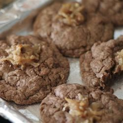 German Chocolate Thumbprint Cookies Recipe - A chewy chocolate cookie topped with a German chocolate icing. Very good, and they freeze wonderfully if you have any left to freeze. Do not substitute canned frosting or you will be disappointed.