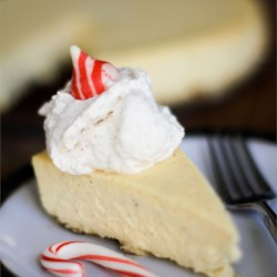 Eggnog Cheesecake III Recipe - A graham cracker crust is filled with a decadent mixture of cream cheese, sugar, eggnog and a hint of rum.  Garnish with whipped cream and colored sugar, if desired.