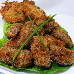 Venison Tenderloin Bites Recipe - Breaded and broiled venison tenderloin is served on a bed of peppery arugula with a drizzle of lemon juice.
