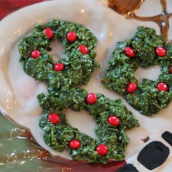 Christmas Cornflake Wreath Cookies Recipe - These cookies look like little Christmas Wreaths and are great fun for the kids to help with.  Very Easy.  People always look at these suspiciously, but once they try them, they can't get enough.  Recipe may be halved.