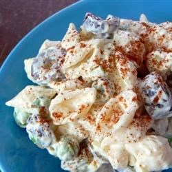 Jim's Macaroni Salad Recipe - A tart and creamy dressing of apple cider vinegar and mayonnaise binds together a festive mix of pasta, chopped eggs, pimentos, dill pickles, onions, bell peppers, olives and tiny squares of American cheese.